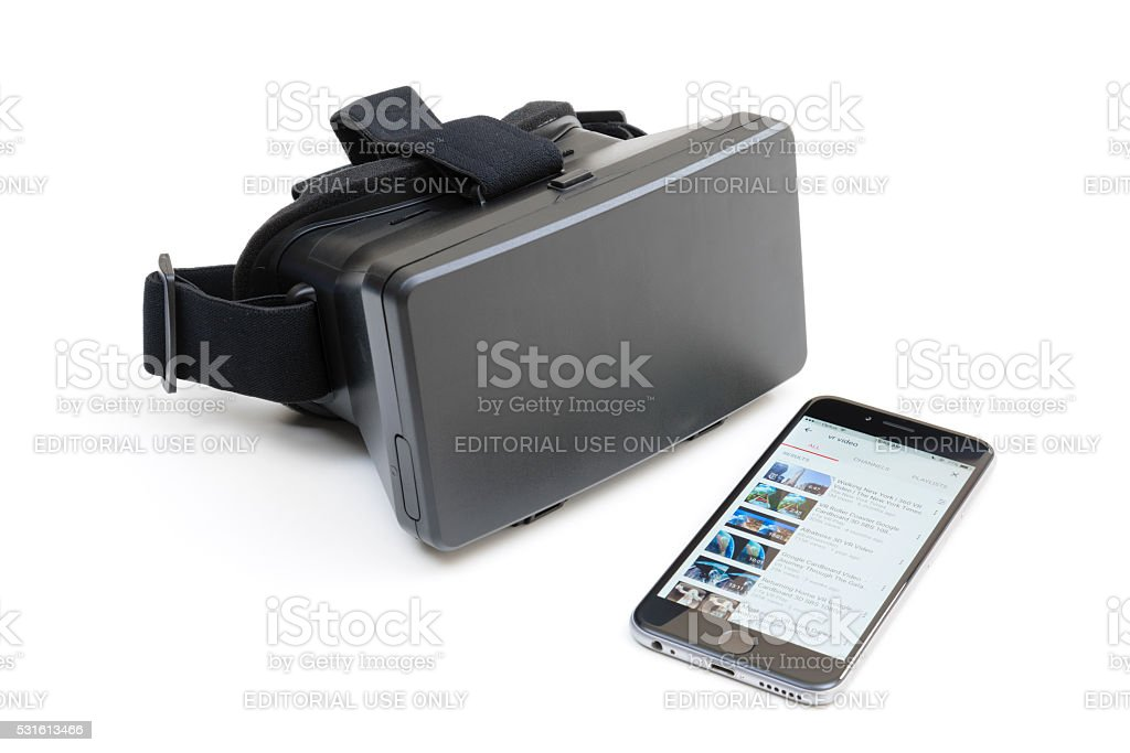 VR headset and iPhone running YouTube app stock photo
