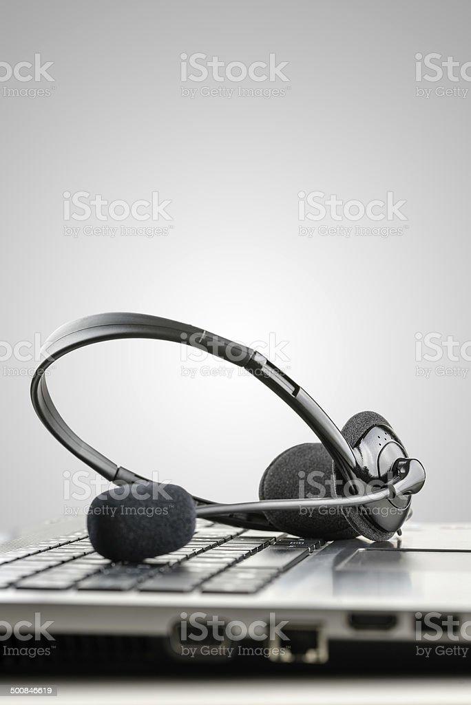 Headset on laptop computer stock photo