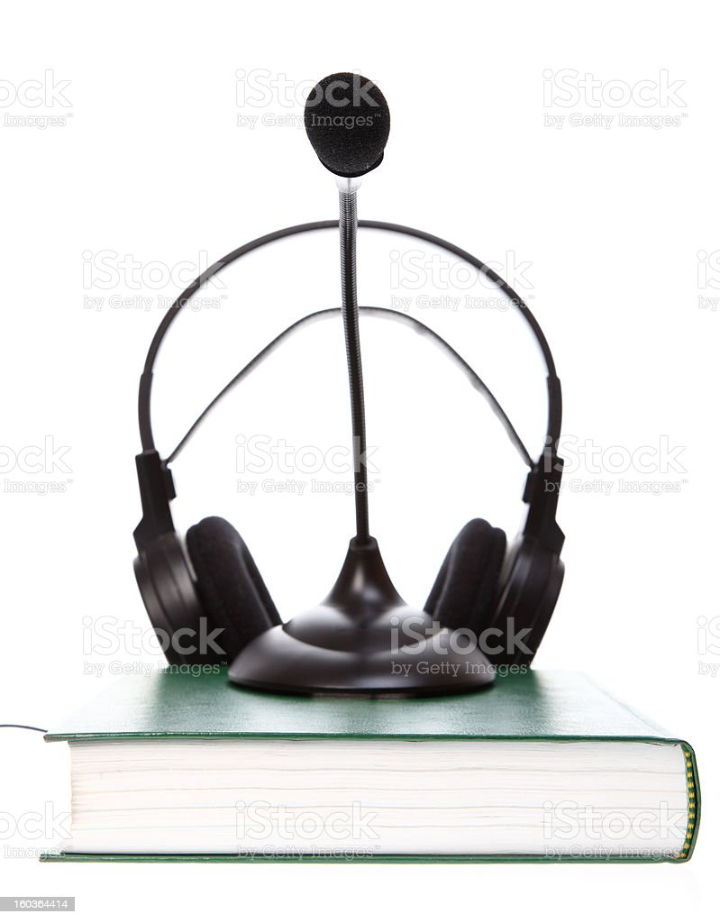 headset with a microphone, hardcover books stack isolated royalty-free stock photo