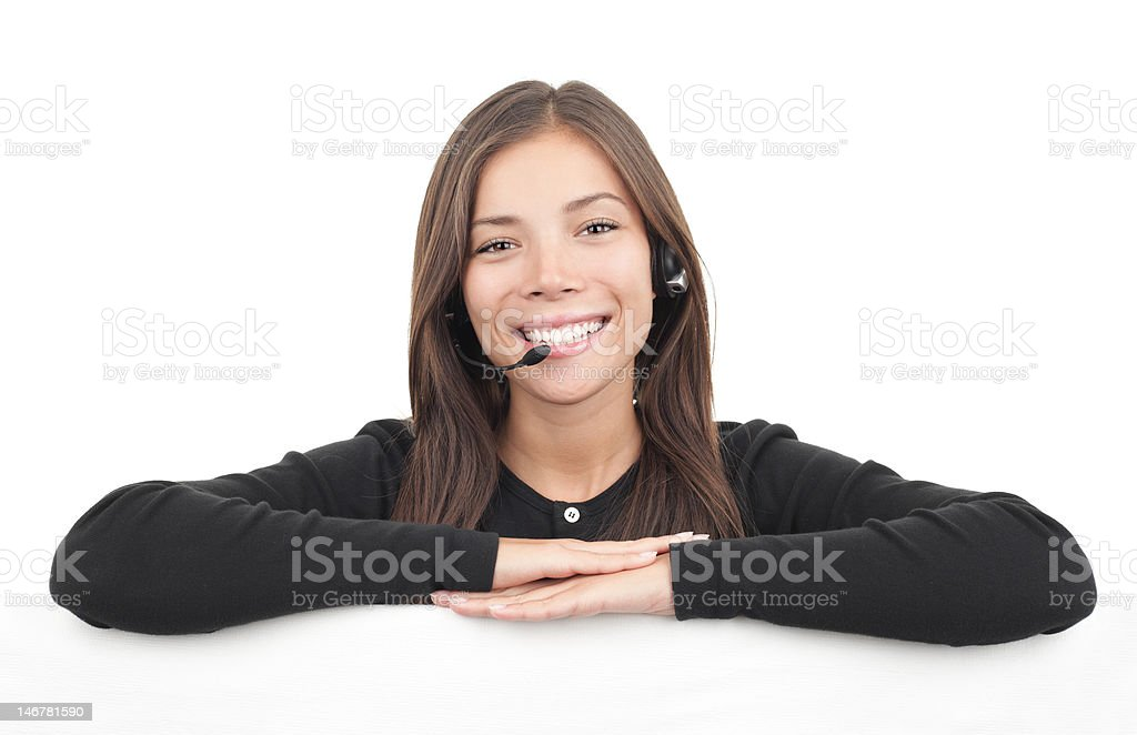 Headset woman from call center leaning over billboard royalty-free stock photo