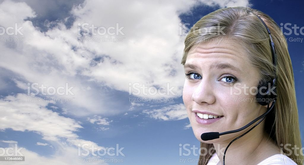 Headset Woman w/Blue Sky Right Smile stock photo