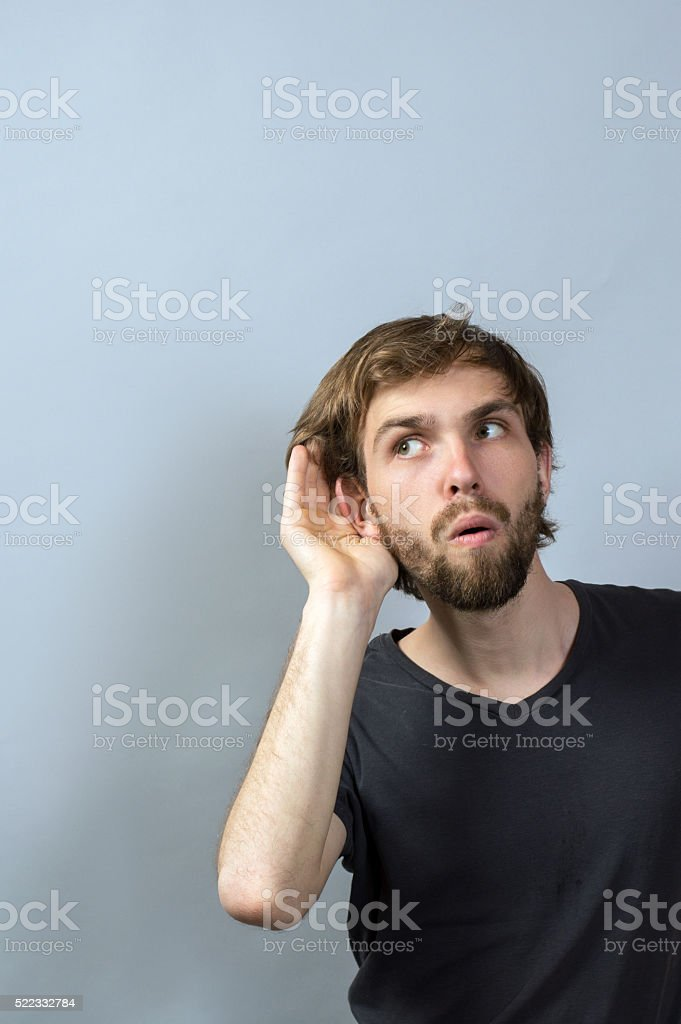 Headshot curious man listening privacy stock photo