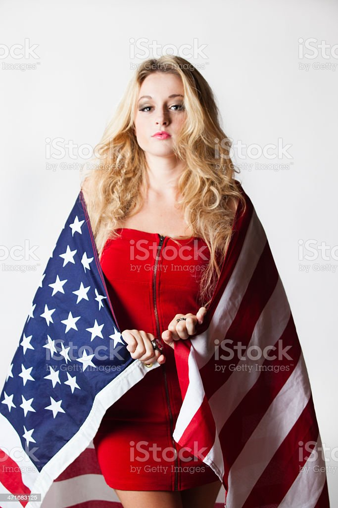Headshot of a Beautiful Blonde Teenager Holding American Flag stock photo