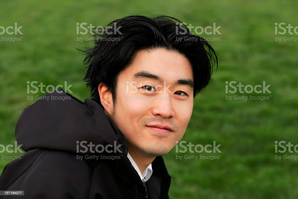 A headshot of a man wearing a black hoodie royalty-free stock photo