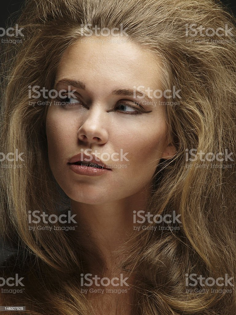 Headshot of a woman with very thick hair stock photo