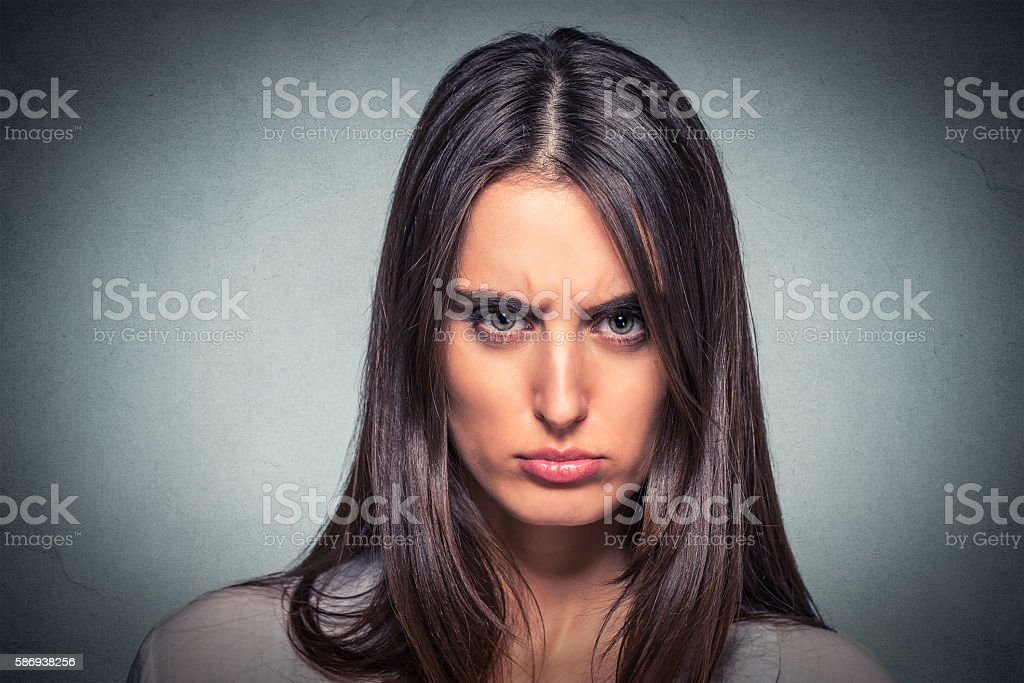 Headshot of an angry young woman stock photo
