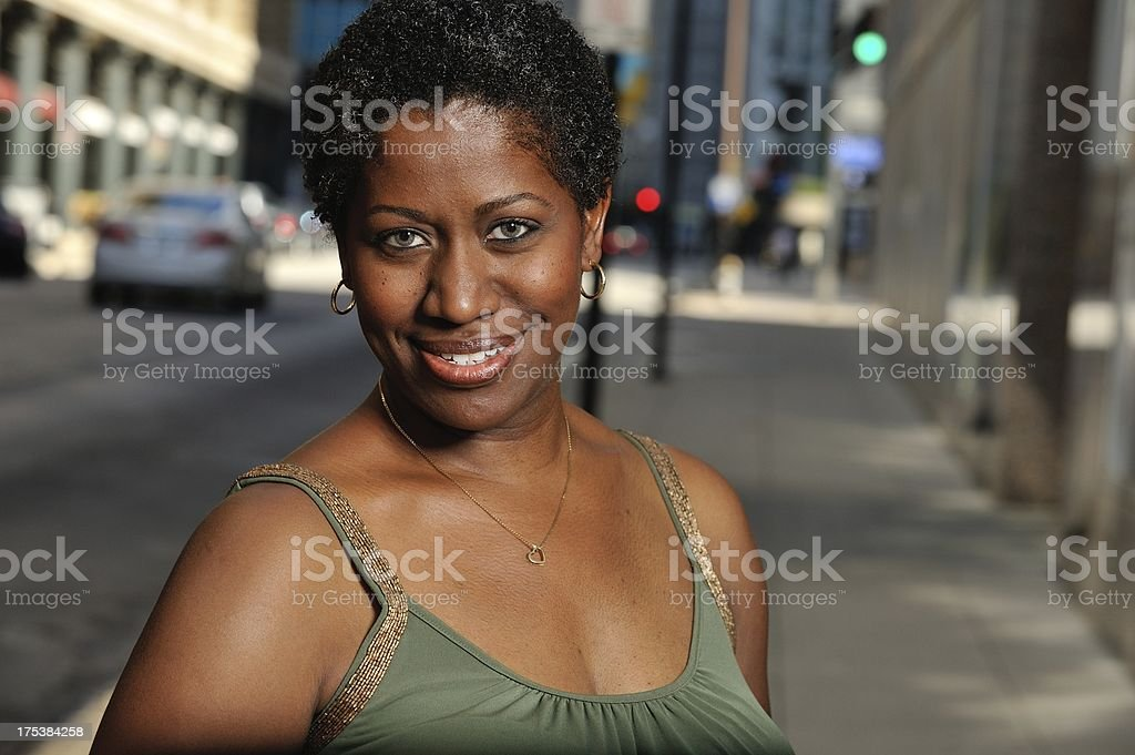 Headshot of black woman in the city royalty-free stock photo