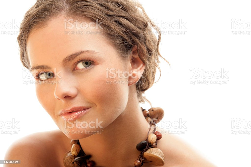 Headshot of pretty brunette woman wearing chunky necklace royalty-free stock photo