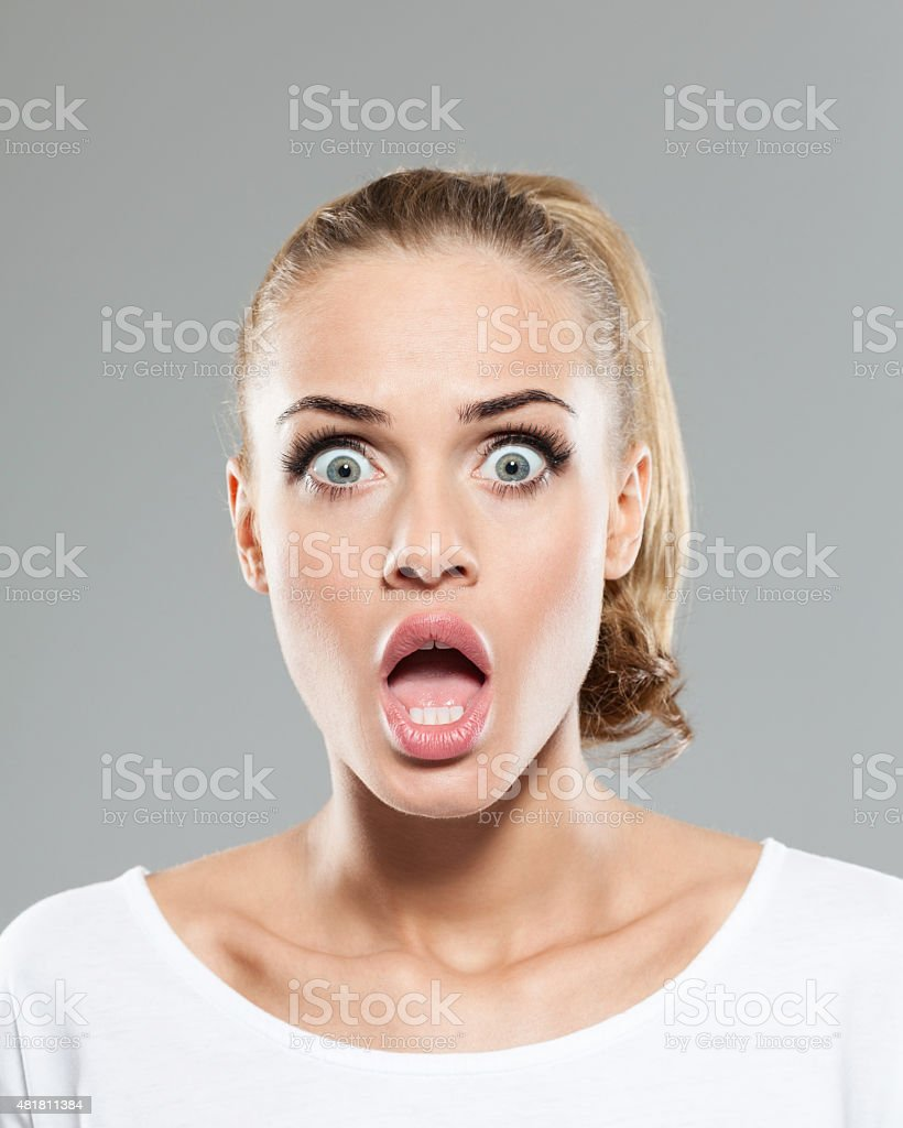 Headshot of shocked blond hair young woman stock photo