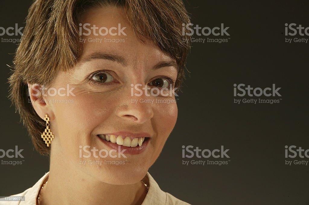 headshot of smiling woman royalty-free stock photo