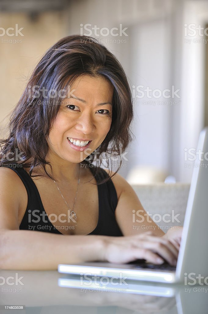 Headshot of Vietnamese Chinese professional woman at home royalty-free stock photo