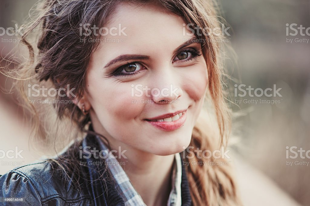 headshot portrait of young adorable woman on cozy country walk stock photo