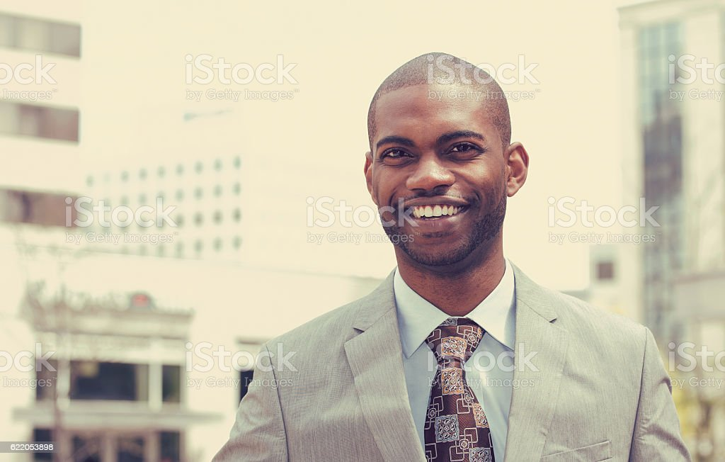 Headshot portrait of young man smiling stock photo