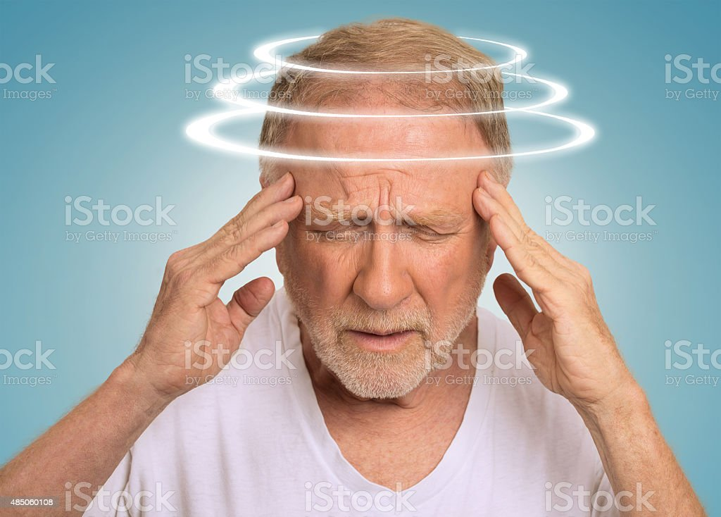 Headshot senior man with vertigo suffering from dizziness stock photo