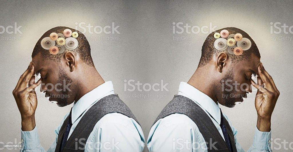 Headshot two thoughtful men, back to back thinking stock photo
