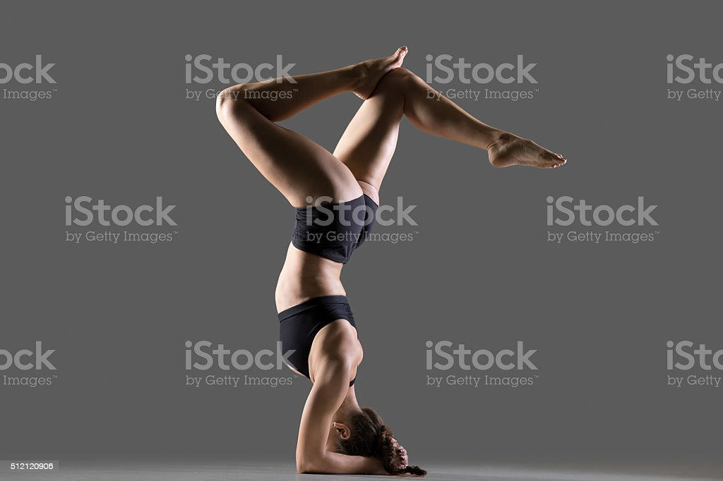 Headstand with bent legs stock photo
