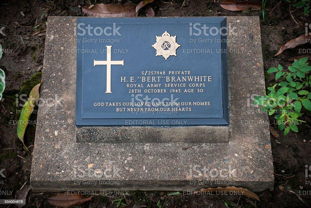 Headstone at Kanchancburi War Cemetery in Thailand stock photo