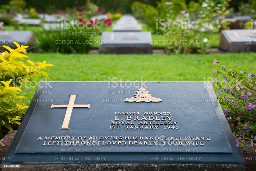 Headstone at Kanchancburi War Cemetery in Thailand stock photo