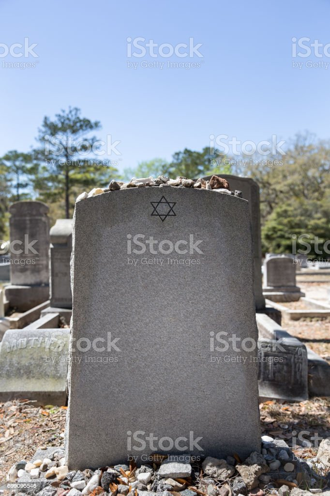 Headstone in Jewish Cemetery with Star of David and Memory Stones stock photo