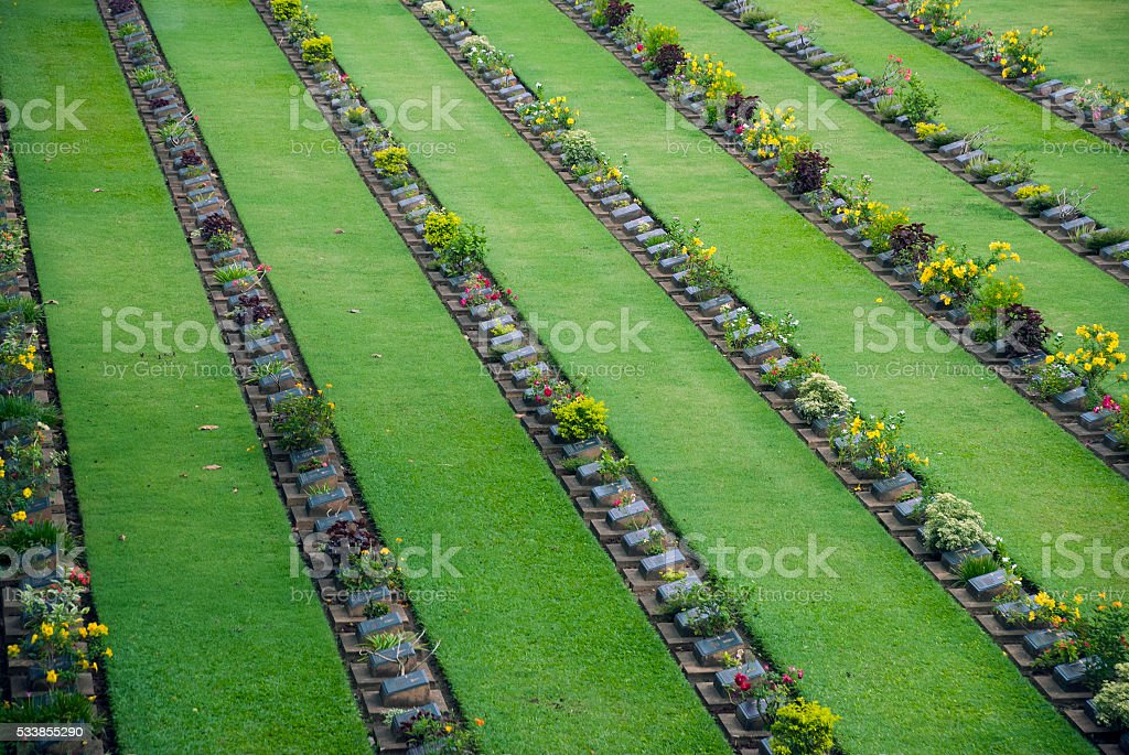 Headstones at Kanchanaburi War Cemetery in Thailand stock photo