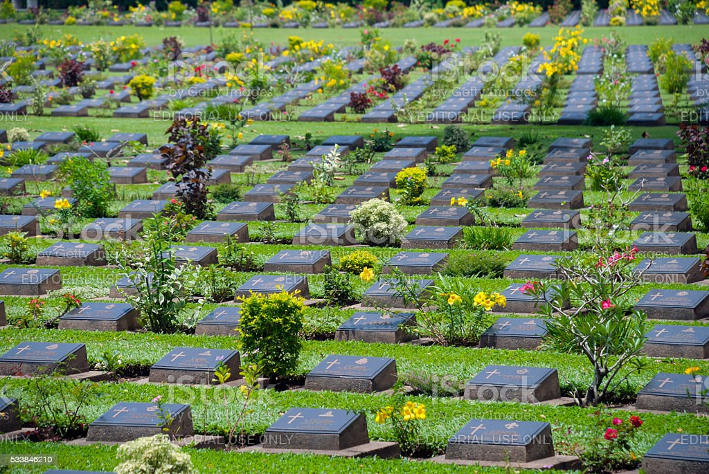 Headstones at Kanchancburi War Cemetery in Thailand stock photo