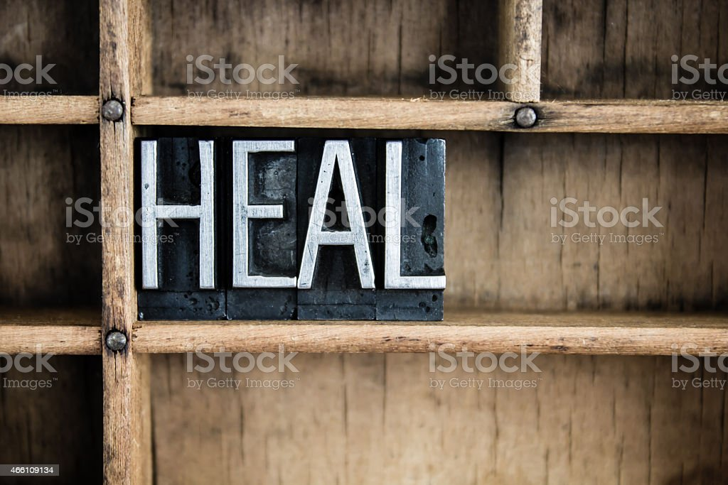 Heal Concept Metal Letterpress Word in Drawer stock photo