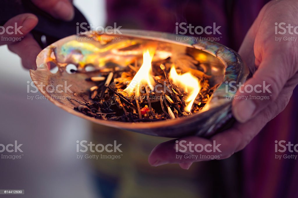 healing ceremony: burning incense in a shell stock photo