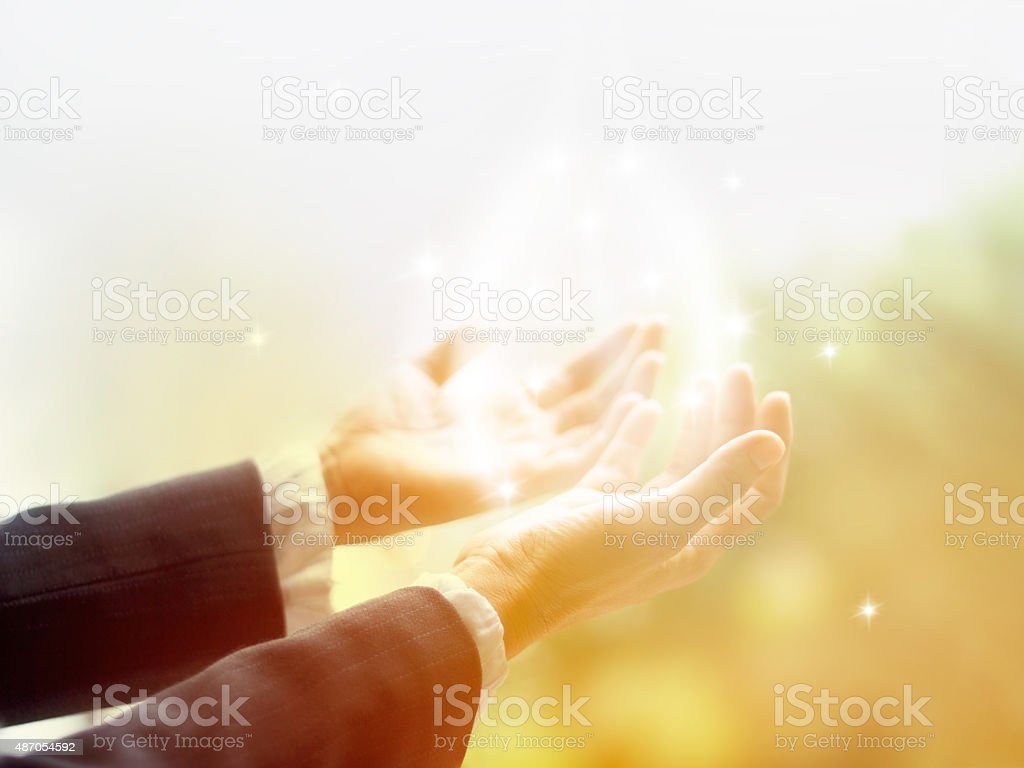 Healing Circle of Light, Old female healer with hands open stock photo