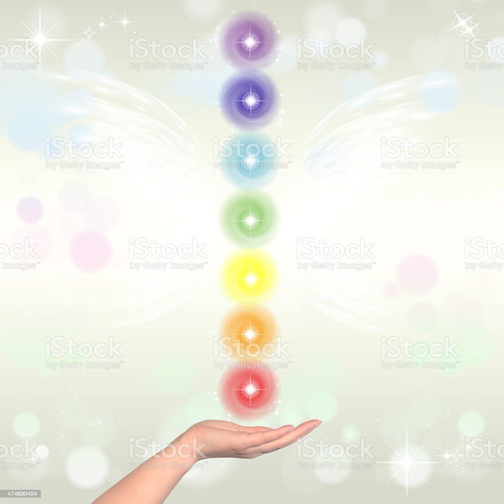 Healing Hand and seven chakras stock photo