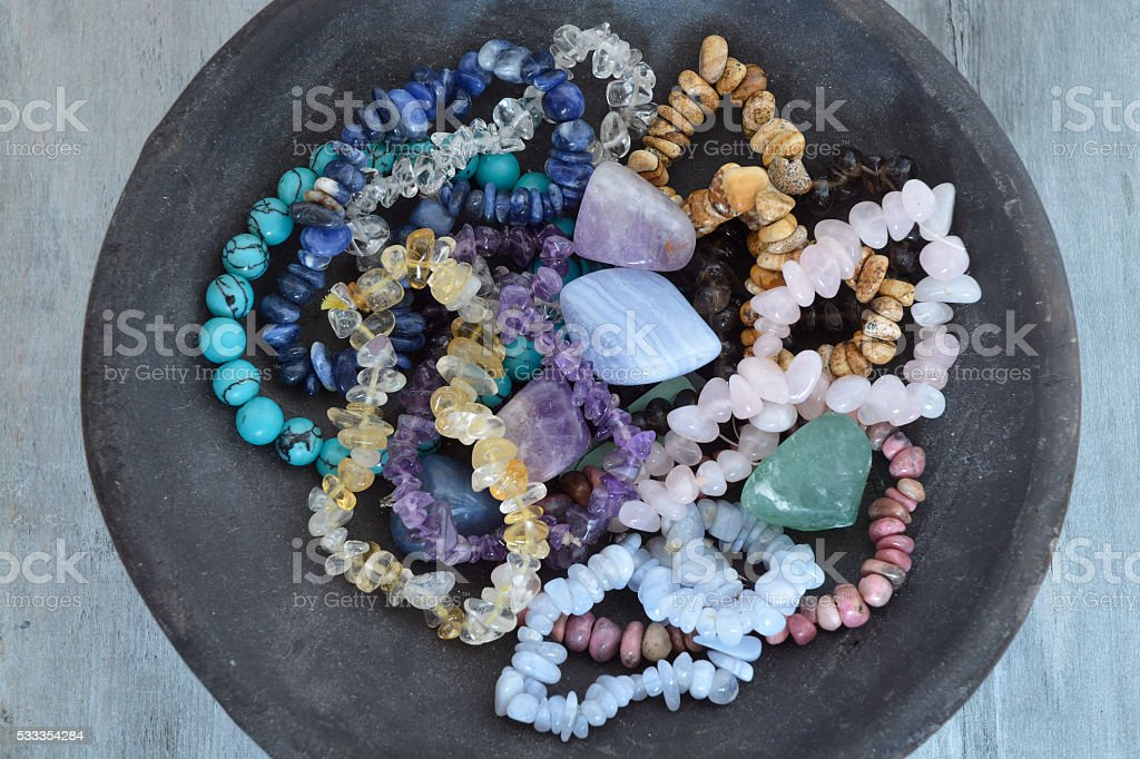 Healing properties of gemstones and crystals on empty wooden background stock photo