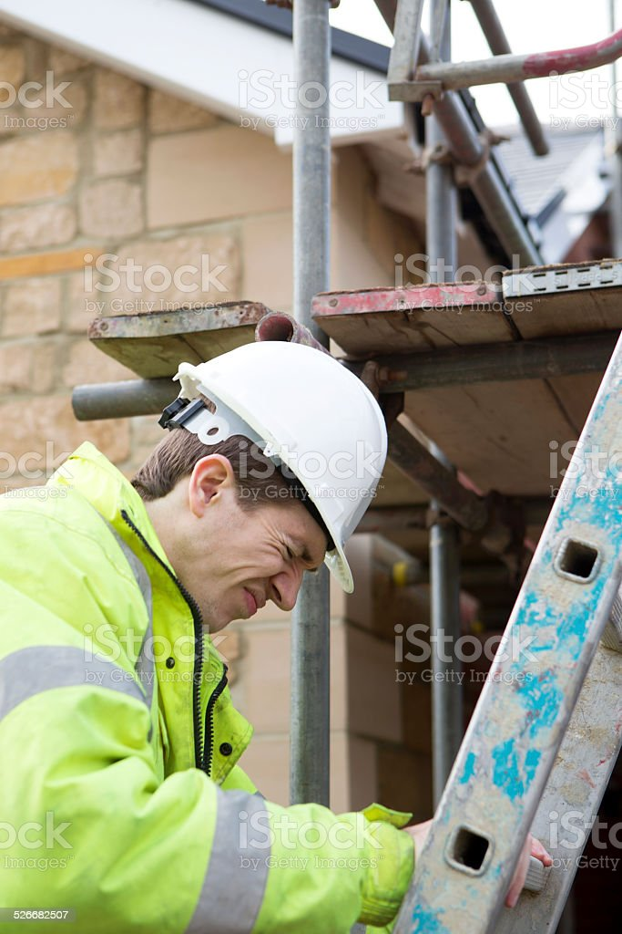 Young Builder hitting his head on some scaffolding
