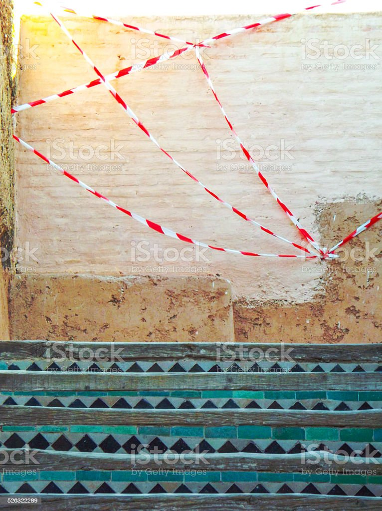 Health and safety tape at top of steps stock photo