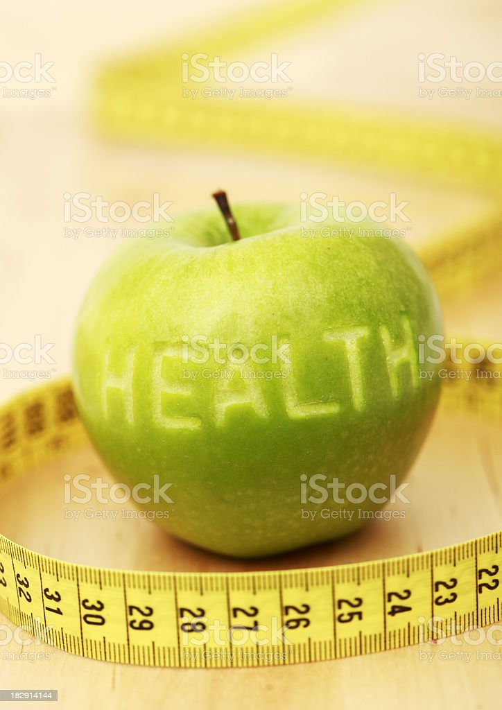 Health, apple and measuring tape royalty-free stock photo