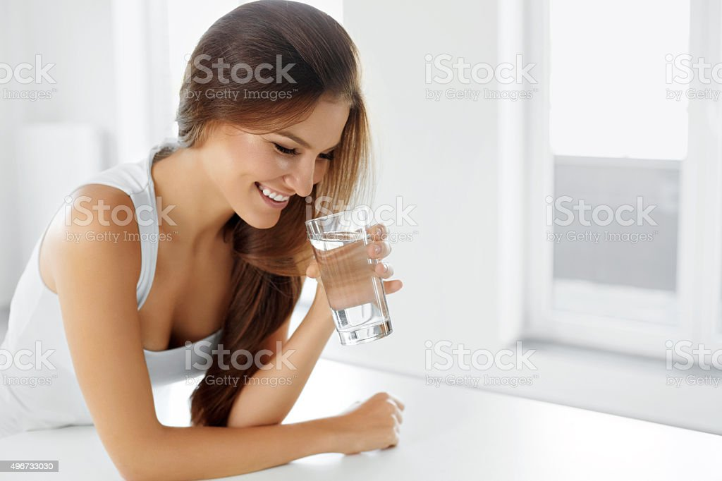 Health, Beauty, Diet Concept. Happy Woman Drinking Water. Drinks stock photo