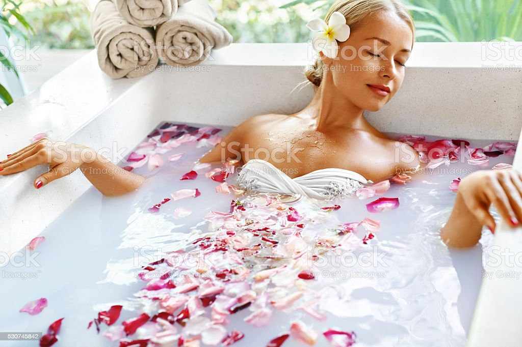 Health, Beauty. Woman Spa Body Care. Relaxing Flower Rose Bath stock photo