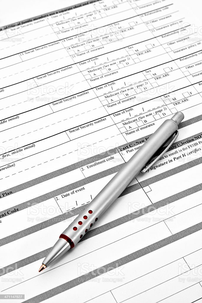 Health Benefits Application Form with Pen royalty-free stock photo