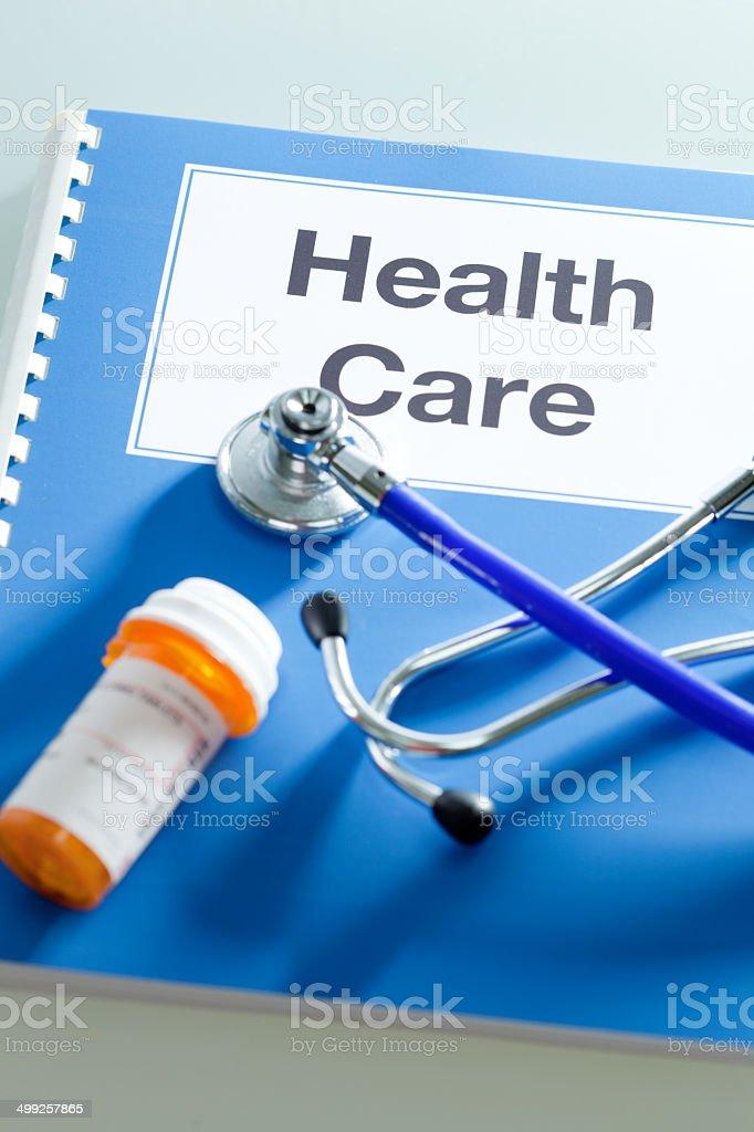 Health Care Handbook Manual with Prescription Medication Vertical royalty-free stock photo