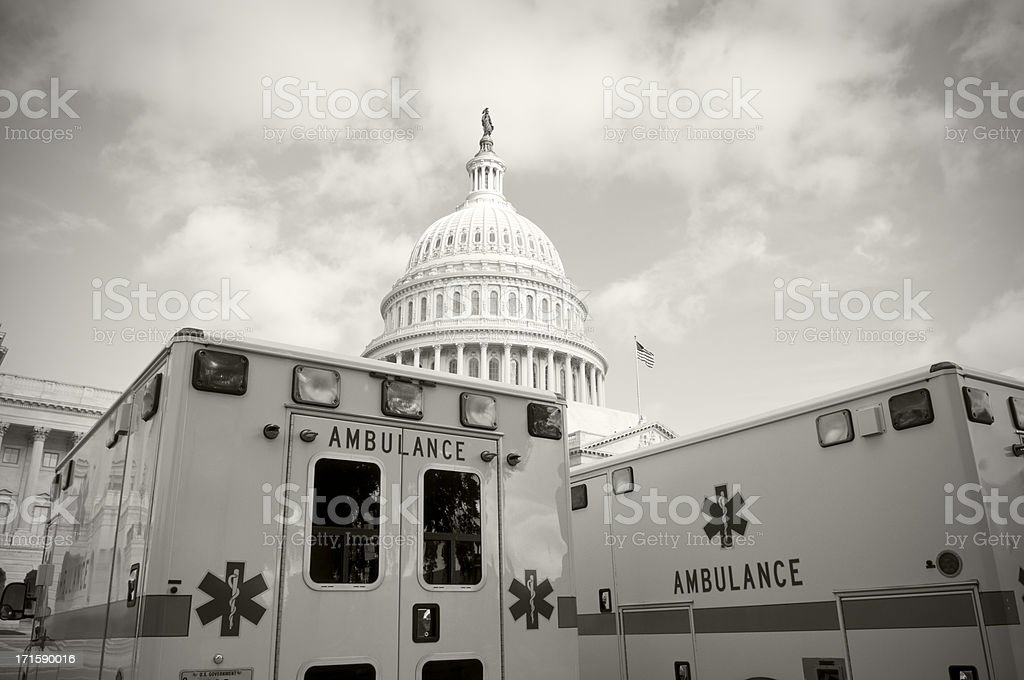 Health Care in America - US Capitol and ambulances stock photo