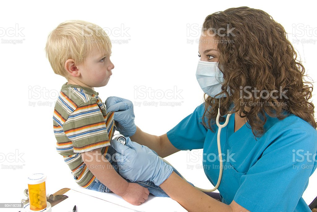 Health Care professional gives check up to toddler royalty-free stock photo