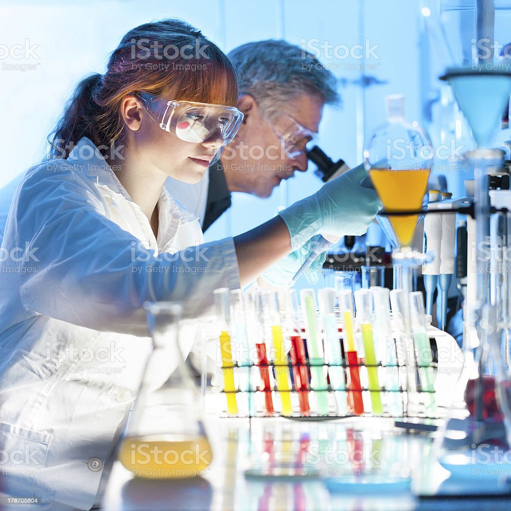 Health care professionals working in laboratory. stock photo