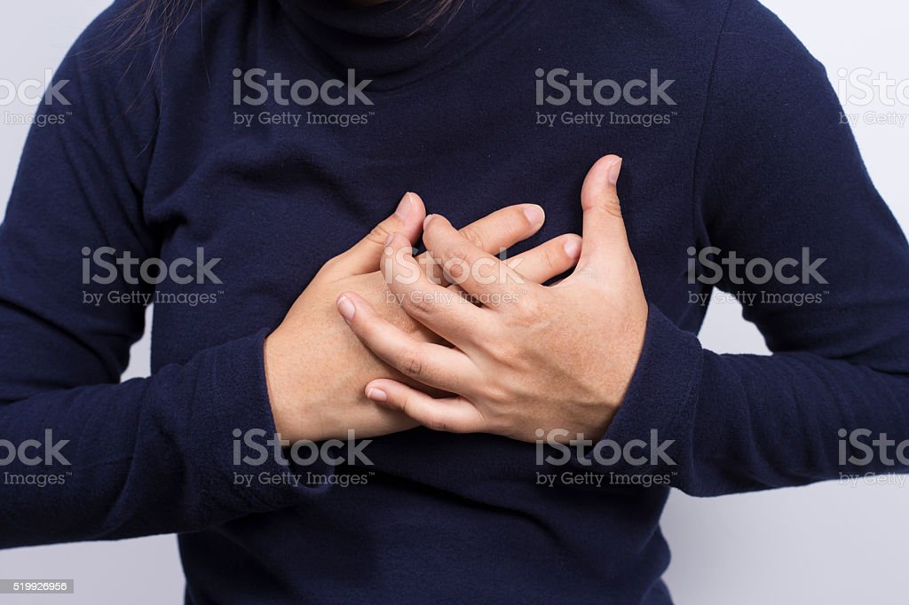 Health Care: Woman has chest pain stock photo