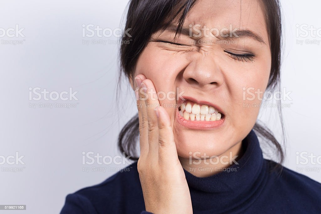Health Care: Woman has toothache stock photo