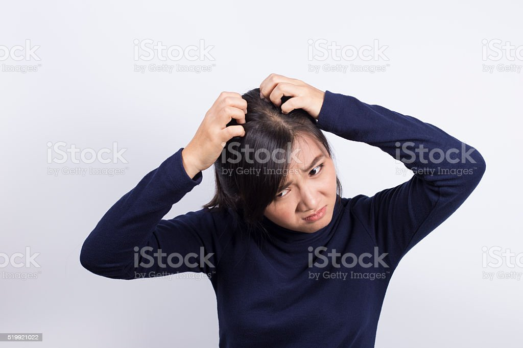 Health Care: Woman scratching her head stock photo