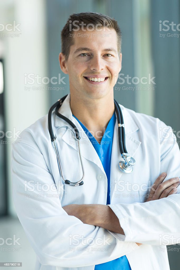 health care worker with arms crossed stock photo