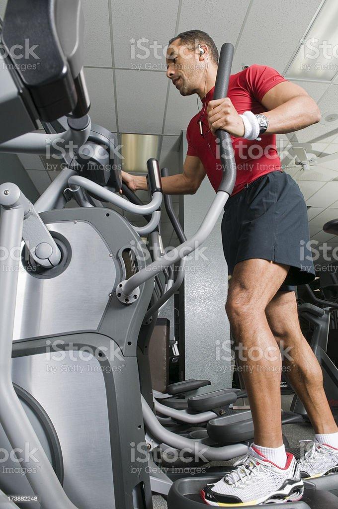 Health Club Workout - Eliptical Machine royalty-free stock photo
