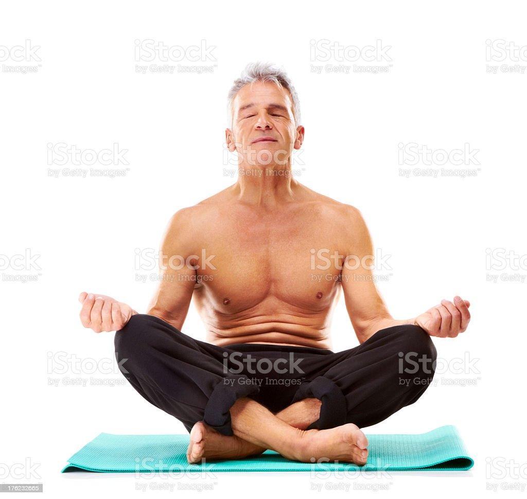 Health concept - Mature guy meditating on white stock photo