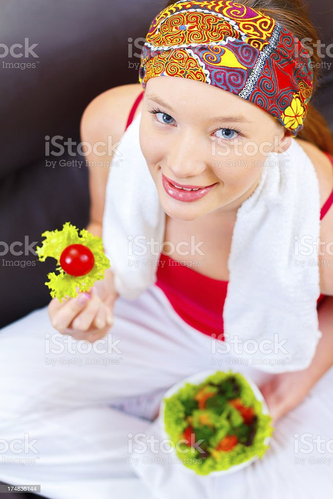 Health conscious teenage girl eating raw vegetable salad royalty-free stock photo