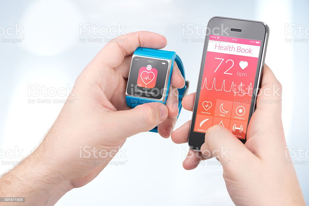 Health data synchronization between smartwatch and smartphone stock photo