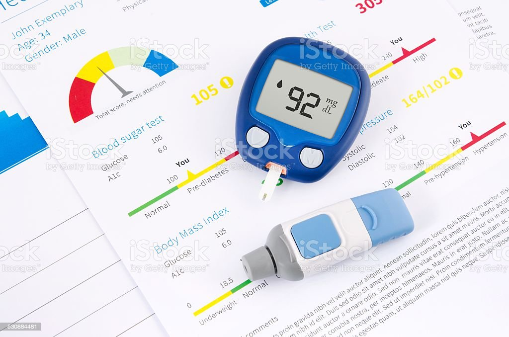 Health examination. Glucometer and test for diabetes stock photo