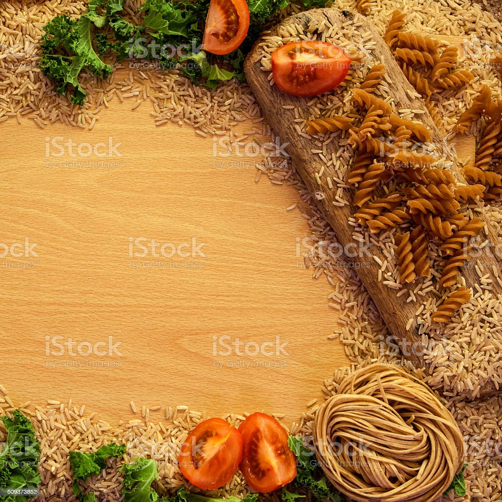 Health Food background, rice, pasta, salad and vegetables. stock photo